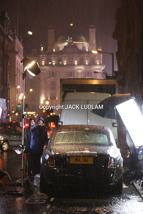 """EXCLUSIVE  .COLIN FARRELL & RAY WINSTONE SHOOTING LONDON GANGESTER FLICK """"LONDON BOULAVARD""""  AT NITE IN THE POURING RAIN IN PICADILLY CIRCUS."""