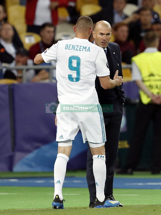 (L-R) Karim Benzema of Real Madrid, coach Zinedine Zidane of Real Madrid during the UEFA Champions League final between Real Madrid and Liverpool on May 26, 2018 at NSC Olimpiyskiy Stadium in Kyiv, Ukraine