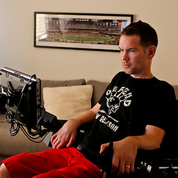 Jan 27, 2013; New Orleans, LA, USA; Former New Orleans Saints defensive back and special teams standout Steve Gleason is seen in his office. Gleason suffers from ALS, considered a terminal neuro-muscular disease.  of Mandatory Credit: Derick E. Hingle-USA TODAY Sports