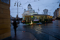 Tramway on Helsinki on Senate square also called Tuomio Kirkko with the lutheran cathedral at dusk. December 2008
