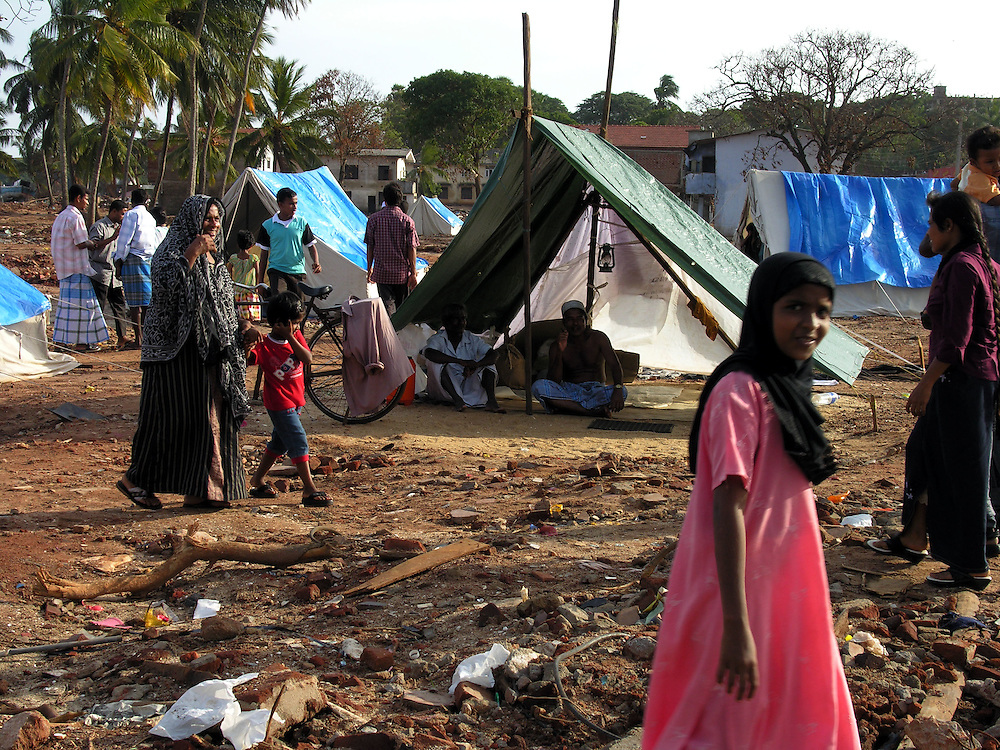 Towns people living in tents on what was the town center following the 26 December, 2004 tsunami that devastated S.E. Asia..Hambantota, Sri Lanka. 21/01/2005  .Photo © J.B. Russell