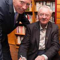 Timmy Dooley TD getting his book signed by RTE Broadcaster Donncha O Dúlaing at Ennis Bookshop on Thursday