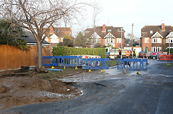 Reading Berkshire Monday 5th December 2016. <br /> Thames Water Say Engineer are looking into it after Caversham house damaged by Sinkholes <br /> <br /> Cracks appear in a house and the driveway sinks when a hole opens up in a road following a water pipe burst.<br /> <br /> Firefighters cordoned off the property after being called to the leak on Kidmore Road, Caversham, Berkshire on Sunday evening.<br /> <br /> Investigations into a burst water pipe which caused a sinkhole in Caversham are under way. <br /> <br /> Eight firefighters were called to the incident on Kidmore Road on Sunday afternoon. <br /> <br /> Sandcroft Road is currently closed at the junction with Kidmore Road.<br /> <br /> Justin CoffeyThames Water engineer  said We  are investigating the cause of the hole &quot;as a matter of priority&rdquo;.  We're investigating why our cast iron water pipe burst and what has caused the damage to the surrounding area. We have informed the council this morning and structural engineers will be appointed to look at the property in Kidmore Road. We need to understand exactly what has happened as a matter of priority, and will work with all the right people to put this right.&quot;<br /> <br /> <br /> Neighbours said a similar incident happened on the same road about 20 years ago. The driveway of the house had &quot;sunk about 2ft&quot; and  a number of cracks could be seen across the house. An Second part of the road has also sunk.<br /> <br /> A structural engineer is to inspect the property.<br /> <br /> People are being asked to move their cars away from the road.&copy;UKNIP