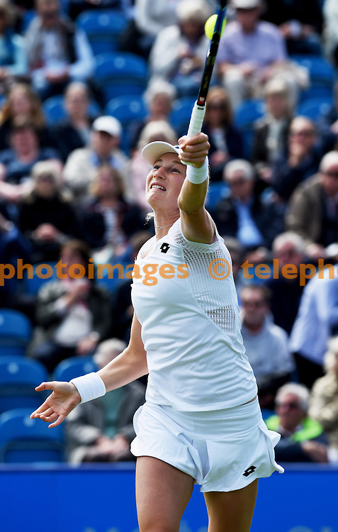 Ekaterina Makarova of Russia plays a forehand shot against Britain's Tara Moore in their first round match during The Aegon International Tournament at Devonshire Park, Eastbourne, Southern England. June 20, 2016.<br /> Simon  Dack / Telephoto Images<br /> +44 7967 642437