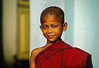 Young novice monk outside the Botataung Pagoda, Yangon (Rangoon), Burma (Myanmar)
