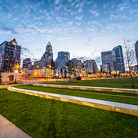 Photo of Charlotte skyline and Romare Bearden Park at dusk. Charlotte, North Carolina is a major city in the Eastern United States of America.