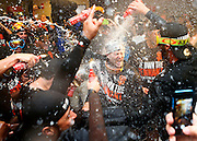 San Francisco Giants's Tim Hudson is sprayed with beer and champagne after winning the National League Championship Series and a trip to the 2014 World Series.