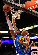 Mar. 14 2010; Phoenix, AZ, USA; New Orleans Hornets forward David West (30) puts up a shot against Phoenix Suns center Louis Amundson (17) in the first half at the US Airways Center. Mandatory Credit: Jennifer Stewart-US PRESSWIRE.