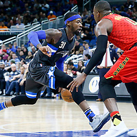 25 February 2017: Orlando Magic forward Terrence Ross (31) drives past Atlanta Hawks forward Paul Millsap (4) during the Orlando Magic 105-86 victory over the Atlanta Hawks, at the Amway Center, Orlando, Florida, USA.