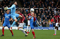 Jack Marriott of Peterborough United lifts the ball over Richard O'Donnell of Northampton Town to score his sides second goal - Mandatory by-line: Joe Dent/JMP - 02/04/2018 - FOOTBALL - ABAX Stadium - Peterborough, England - Peterborough United v Northampton Town - Sky Bet League One
