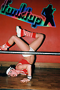 A female dancer break dancing at Funktup, December 2004