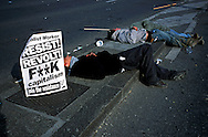 Demonstrators sleeping on blockaded Pont du Mont Blanc before an Anti-G8 Summit demonstration  through Geneva. The Summit was at Evian in neighbouring France...©Mark Henley