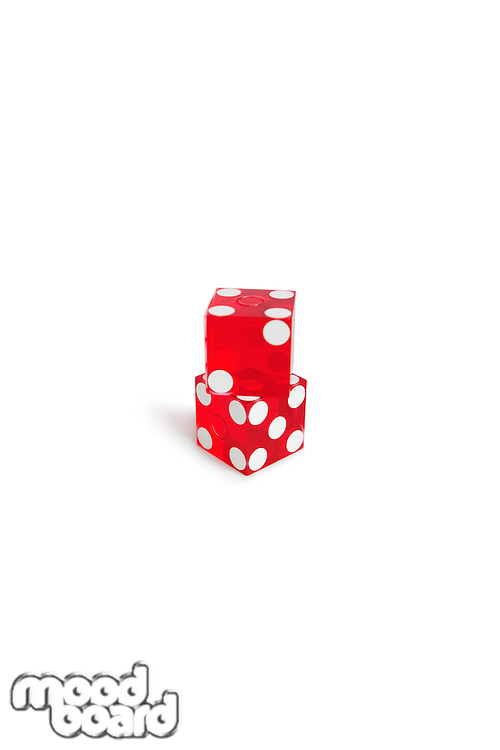 Red gambling dice over white background