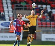Newport County player Mark Byrne and Dagenham player Christian Doidge compete for a high ball during the Sky Bet League 2 match between Dagenham and Redbridge and Newport County at the London Borough of Barking and Dagenham Stadium, London, England on 19 September 2015. Photo by Bennett Dean.