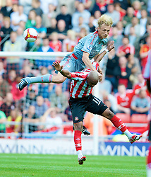 SUNDERLAND, ENGLAND - Saturday, August 16, 2008: Liverpool's Sami Hyypia and Sunderland's El-Hadji Diouf during the opening Premiership match of the season at the Stadium of Light. (Photo by David Rawcliffe/Propaganda)