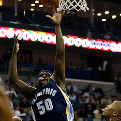 Jan 20, 2010; New Orleans, LA, USA; Memphis Grizzlies forward Zach Randolph (50) shoots over New Orleans Hornets forward David West (30)during the first half at the New Orleans Arena. Mandatory Credit: Derick E. Hingle-US PRESSWIRE