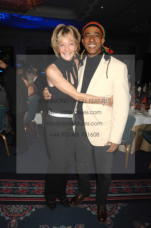 WENDY KIDD and performance poet AJA at a dinner to promote the Holders Season in Barbados held at The Four Seasons Hotel, Hamilton Place, London W1 on 30th January 2008.<br /> <br /> NON EXCLUSIVE - WORLD RIGHTS (EMBARGOED FOR PUBLICATION IN UK MAGAZINES UNTIL 1 MONTH AFTER CREATE DATE AND TIME) www.donfeatures.com  +44 (0) 7092 235465