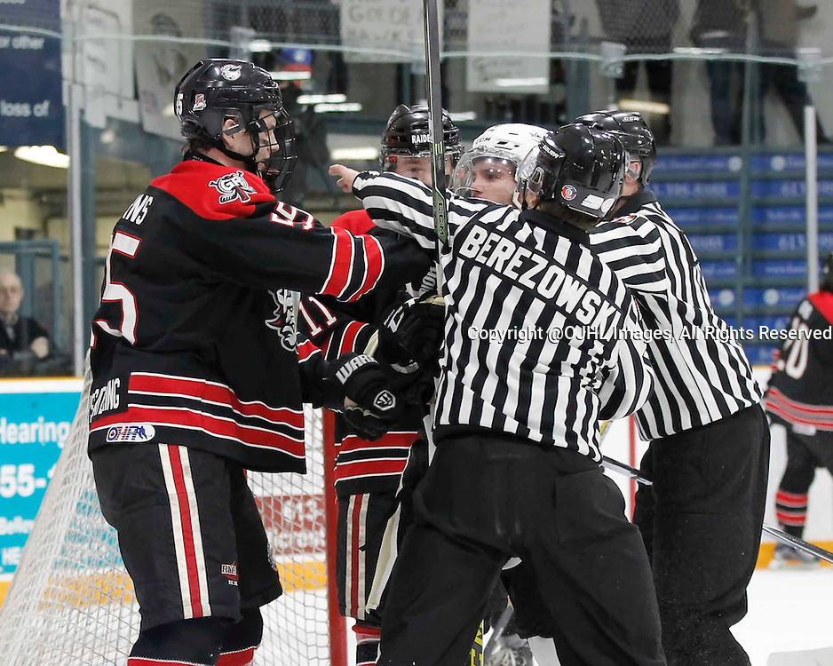 TRENTON, - Apr 14, 2016 -  Ontario Junior Hockey League game action between the Trenton Golden Hawks and the Georgetown Raiders. Game 1 of the Buckland Cup Series, OHA Linesman Berezowski during an altercation between Trenton Golden Hawks #14 Ethan Skinner and Matthew Cairns #55 of the Georgetown Raiders at the Duncan Memorial Gardens, ON. (Photo by Amy Deroche / OJHL Images)