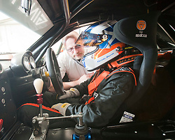 Jules Phillips, general manager of Aurok Limited, helps Christie to strap into her Ginetta car..British Touring Car Championship at Knockhill, Sunday 4th September 2011. .© pic Michael Schofield.