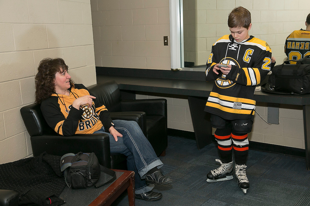 February 8, 2015, Boston, Massachusetts:<br /> Make-A-Wish recipient Jimmy Bjorkman of West Salem, Wisconsin and family chat before a hockey game between the Boston Bruins and the Montreal Canadiens at TD Garden in Boston, Massachusetts Sunday, February 8, 2015.<br /> (Photo by Billie Weiss/Make-A-Wish)