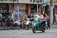moped riders in Shanghai China