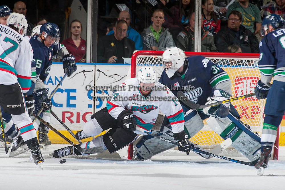 KELOWNA, CANADA - APRIL 22: Rourke Chartier #14 of Kelowna Rockets falls to the ice in front of Landon Bow #30 of Seattle Thunderbirds on April 22, 2016 at Prospera Place in Kelowna, British Columbia, Canada.  (Photo by Marissa Baecker/Shoot the Breeze)  *** Local Caption *** Landon Bow; Rourke Chartier;