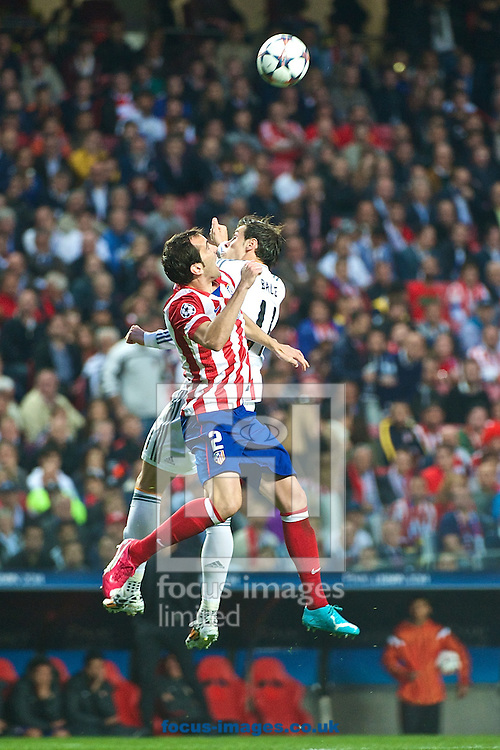 Diego God&iacute;n of Atletico Madrid (left) and Gareth Bale of Real Madrid during the UEFA Champions League Final at Est&aacute;dio da Luz, Lisbon<br /> Picture by Ian Wadkins/Focus Images Ltd +44 7877 568959<br /> 24/05/2014