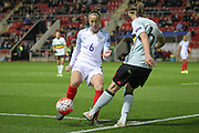 Casey Stoney (England) blocks the cross by Tine De Caigny (Belgium) during the Euro 2017 qualifier between England Ladies and Belgium Ladies at the New York Stadium, Rotherham, England on 8 April 2016. Photo by Mark P Doherty.