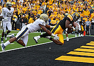 September 17, 2011: Iowa Hawkeyes wide receiver Keenan Davis (6) pulls in a 14 yard touchdown catch in front of Pittsburgh Panthers defensive back K'Waun Williams (2) during the second half of the game between the Iowa Hawkeyes and the Pittsburgh Panthers at Kinnick Stadium in Iowa City, Iowa on Saturday, September 17, 2011. Iowa defeated Pittsburgh 31-27.