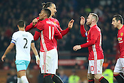 Anthony Martial Forward of Manchester United is congratulated by Zlatan Ibrahimovic Forward of Manchester United and Wayne Rooney Forward of Manchester United during the EFL Cup Quater-Final between Manchester United and West Ham United at Old Trafford, Manchester, England on 30 November 2016. Photo by Phil Duncan.