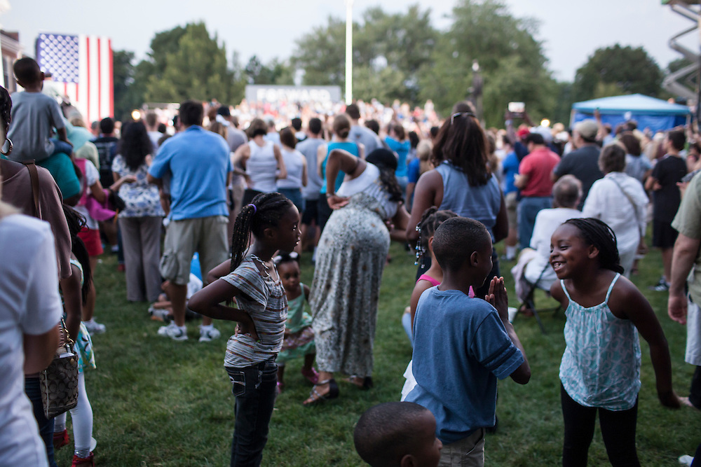 ARLINGTON, VA - AUGUST 2: Children play as President Barack Obama holds a campaign rally at Loudoun County High School on August 2, 2012 in Leesburg, VA. Obama campaigned earlier in the day in Florida. (Photo by Brendan Hoffman/Getty Images) *** Local Caption ***