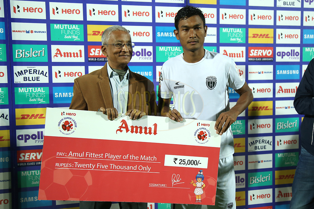 Hali Charan Narzary of Northeast United FC receive fittest player of the match award during match 19 of the Hero Indian Super League between NorthEast United FC and Bengaluru FC held at the Indira Gandhi Athletic Stadium, Guwahati India on the 8th December 2017<br /> <br /> Photo by: Deepak Malik  / ISL / SPORTZPICS