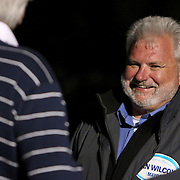 Candidate for Carolina Beach Mayor Dan WIlcox laughs with voters outside of the Carolina Beach Recreation Center in Carolina Beach. (Jason A. Frizzelle)