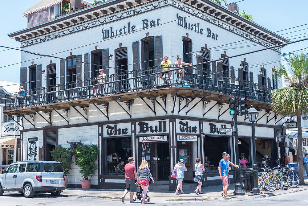 Key West, Florida--April 29, 2018. Patrons relax on the second floor balcony of the Whistle Bar along Duval Street in Key West. Editorial Use Only.