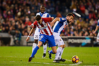 Atletico de Madrid's player Yannick Carrasco and RCD Espanyol player Javi Fuego and Papakouli Diop during match of La Liga between Atletico de Madrid and RCD Espanyol at Vicente Calderon Stadium in Madrid, Spain. December 03, 2016. (ALTERPHOTOS/BorjaB.Hojas)