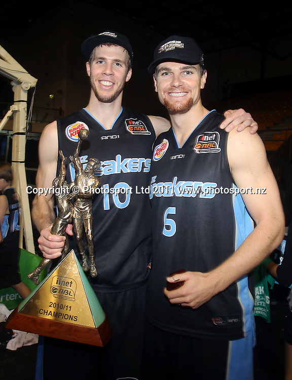 Breakers' Tom Abercrombie and Kirk Penney pose with the Dr. John Raschke Trophy. iinet ANBL, Grand Final Game 3, New Zealand Breakers vs Cairns Taipans, North Shore Events Centre, Auckland, New Zealand. Friday 29th April 2011. Photo: Anthony Au-Yeung / photosport.co.nz