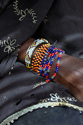 BURKINA FASO, Gorom-Gorom, 2007. Handmade bracelets are only a few of the many adornments of this Bella vegetable vendor at Gorom-Gorom's regional market.