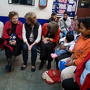 Representative Kay Granger tells pregnant women that she has five grandchildren during CARE's Learning Tour visit to the San Cosme Health Center. San Cosme is a slum in Lima that has the highest rate of tuberculosis in Lima, but has limited health services for the community. The Global Fund is supporting services in San Cosme's health center.