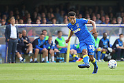 AFC Wimbledon striker Lyle Taylor (33) is watched by AFC Wimbledon bench during the EFL Sky Bet League 1 match between AFC Wimbledon and Shrewsbury Town at the Cherry Red Records Stadium, Kingston, England on 24 September 2016. Photo by Stuart Butcher.