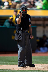 OAKLAND, CA - APRIL 11:  MLB umpire Mark Carlson #6 calls a strike during the seventh inning between the Oakland Athletics and the Seattle Mariners at O.co Coliseum on April 11, 2015 in Oakland, California. The Seattle Mariners defeated the Oakland Athletics 5-4 in 11 innings. (Photo by Jason O. Watson/Getty Images) *** Local Caption *** Mark Carlson