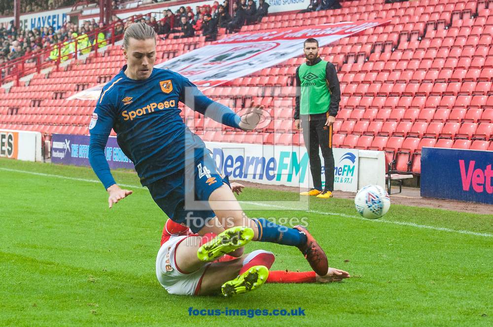 Jackson Irvine of Hull City is tackled by Jason McCarthy of Barnsley during the Sky Bet Championship match at Oakwell, Barnsley<br /> Picture by Matt Wilkinson/Focus Images Ltd 07814 960751<br /> 21/10/2017