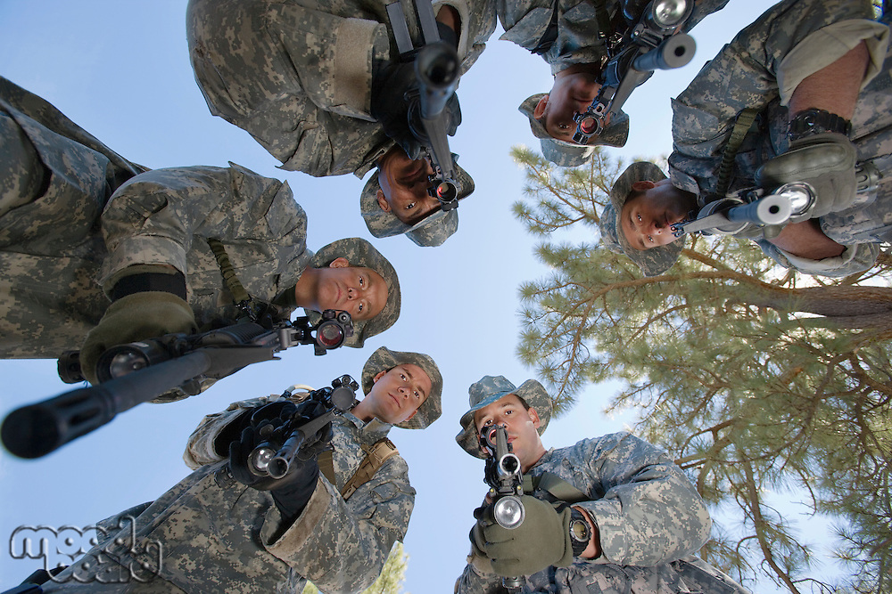 Low angle portrait of armed soldiers
