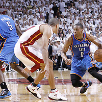 21 June 2012: Oklahoma City Thunder point guard Russell Westbrook (0) makes a crossover drible during the second quarter of Game 5 of the 2012 NBA Finals, at the AmericanAirlinesArena, Miami, Florida, USA.