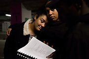 Cast members Lou Mussington (left) and Ishara Bilson-Graham (centre) and Rowan Fornah (right) work through the script during rehearsals in an underground car park, where the performance will be held.<br /> The full-scale production, which runs from 8th Nov - 2nd of Dec 2017 under Smithfield Meat Market, has been put together by charity The Big House, a charity that helps troubled youths who have been in care.