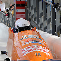 01 March 2009:     The Netherlands 1 bobsled driven by Edwin Van Calker with sidepushers Arno Klaasen and Sybren Jansma and brakeman Timothy Beck finish their 7th place run at the 4-Man World Championships competition on March 1 at the Olympic Sports Complex in Lake Placid, NY.   The USA 1 bobsled driven by Steven Holcomb with sidepushers Justin Olsen and Steve Mesler, and brakeman Curtis Tomasevicz won the competition and the World Championship bringing the U.S. their first world championship since 1959 with a time of 3:36.61.