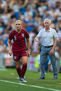 Alex Greenwood (England) with Tom Sermanni, Head Coach of New Zealand FC  in the background during the FIFA Women's World Cup UEFA warm up match between England Women and New Zealand Women at the American Express Community Stadium, Brighton and Hove, England on 1 June 2019.