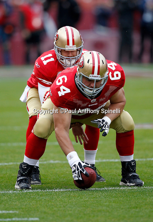 San Francisco 49ers guard David Baas (64) snaps the ball to San Francisco 49ers quarterback Alex Smith (11) during the NFL week 17 football game against the Arizona Cardinals on Sunday, January 2, 2011 in San Francisco, California. The 49ers won the game 38-7. (©Paul Anthony Spinelli)