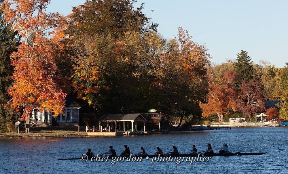 High school rowers pause in their boat after a practice row in Greenwood Lake, NY on Friday afternoon, October 23, 2015.  © Chet Gordon • Photographer