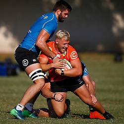 DURBAN, SOUTH AFRICA - MAY 21: Dylan Richardson is tackled by Kieren Van Vuuren and Ruben van Heerden of the Cell C Sharks during the Cell C Sharks training session at Jonsson Kings Park on May 21, 2019 in Durban, South Africa. (Photo by Steve Haag/Gallo Images)