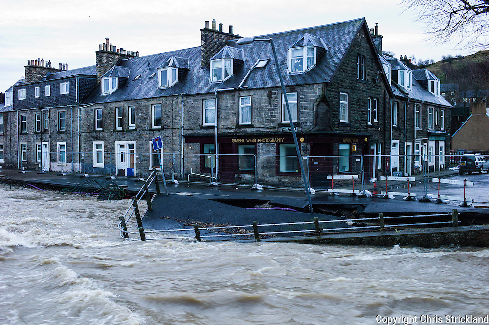 Hawick, Scotland, UK. 6th December 2015. A pathway next to the River Teviot in Hawick collapsed overnight due to the force of the running water.